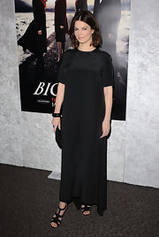 Jeanne Tripplehorn balanced a modest black dress with black strappy heels.