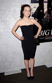 Tina keeps her look simple in a little black strapless dress.