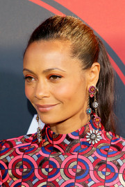Thandie Newton accessorized with a pair of dangling flower earrings by Vickisarge for added vibrance to her geometric-print outfit.