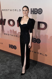 Evan Rachel Wood got glam in a beaded black Versace gown with puffed sleeves and a high slit for the premiere of 'Westworld' season 3.