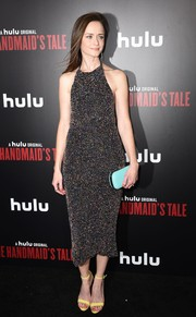 Alexis Bledel added an extra pop of pastel with a blue Lili Radu clutch.