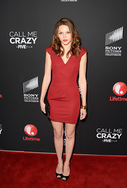 Aimee Teegarden showed off her fit figure with this structured red frock.