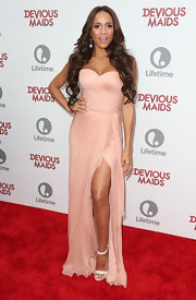 Dania Ramirez chose a light blush-colored strapless down for her look at the 'Devious Maids' premiere.
