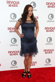 Judy Reyes sported this midnight blue cocktail dress with a sheer overlay at the 'Devious Maids' premiere.
