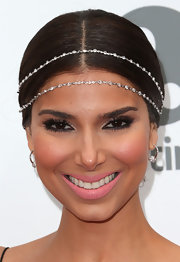 Roselyn Sanchez pulled back her chocolate brown tresses into a classic bun for the premiere of 'Devious Maids.'