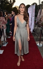 Troian Bellisario sizzled at the premiere of 'Sister Cities' in a gray slip dress with a deep-V neckline and a high slit.