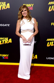 Connie Britton continued the minimalist-chic vibe with a white Rauwolf box clutch.