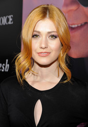 Katherine McNamara wore a loose updo with wavy tendrils framing her face during the premiere of 'The Choice.'