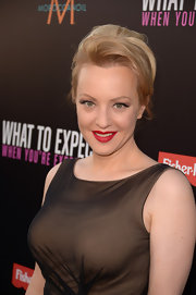 Wendi McLendon-Covey arrived at the premiere of 'What to Expect When You're Expecting' wearing her smooth strands in a voluminous updo.