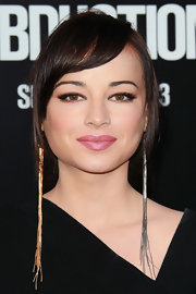To recreate Ashley Rickards' lip look, try a full-coverage, moisturizing lipstick with a subtly pearlescent finish. We recommend Maybelline SuperStay Lipstick in a shade like Infinite Petal or Laura Mercier Shimmer Lip Colour in Ameythst.
