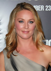 Elisabeth Rohm wore her shoulder-length locks slightly feathered at the premiere of 'Abduction'. To recreate her look curl two-inch sections away from the face and mist with a medium hold hairspray.
