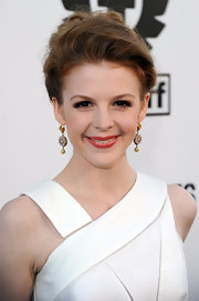 Ashley Bell paired her elegant updo with gold dangle earrings.