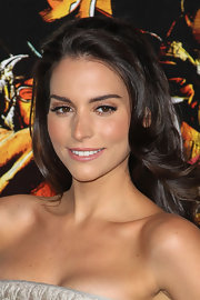 Genesis Rodriguez wore a natural shade of lipstick at a movie premiere.