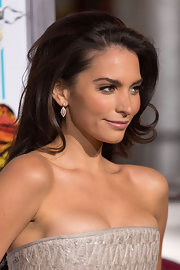 Genesis Rodriguez styled her look with a pair of dangling leaf earrings at a movie premiere.
