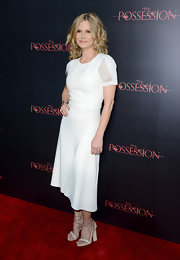 Kyra Sedgwick finished out the summer season strong with an impeccably fresh Reed Krakoff white dress. We're loving the sheer panels on the sleeves too—what a perfectly playful peek-a-boo!