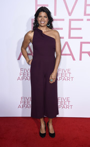 Andrea Navedo attended the premiere of 'Five Feet Apart' wearing a plum one-shoulder jumpsuit.