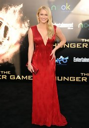 Leven Rambin wore this red beaded gown with a deep-V to the LA premiere of 'The Hunger Games.'