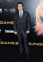 Josh Hutcherson hit the red carpet of 'The Hunger Games' in a gray three piece suit and a striped tie.
