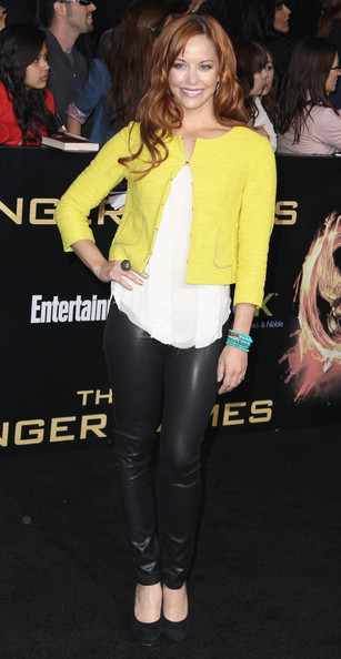 Amy Paffrath accessorized with black suede pumps.