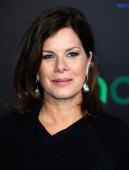 Marcia Gay Harden attended the premiere of 'The Hunger Games' wearing all-black and silver dangling earrings.