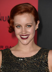 Bruce Bundy went to the 'Catching Fire' LA premiere sporting a retro-glam updo.
