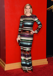 For the 'Hunger Games: Mockingjay - Part 2' premiere, Elizabeth Banks chose a Dolce & Gabbana column dress in multicolored sequin stripes punctuated with sheer black lace. She really knows how to wow!