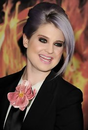 Kelly Osbourne attended the premiere of 'The Hunger Games' wearing her hair in a classic voluminous French twist with long side-swept bangs.