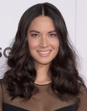Olivia Munn looked fun and flirty with her thick, bouncy curls at the premiere of 'Mortdecai.'