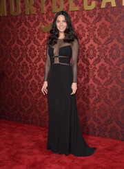 Olivia Munn burned up the red carpet in a black Ralph Rucci gown with a skin-revealing bodice during the premiere of 'Mortdecai.'