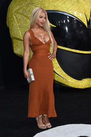 Christina Milian put on an eye-popping display in a cleavage-flaunting burnt-orange knit maxi dress by Victoria Beckham at the LA premiere of 'Power Rangers.'