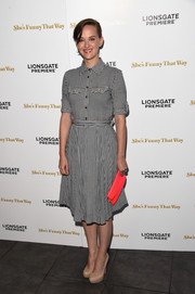Jess Weixler's neon-orange clutch totally popped against her monochrome dress.