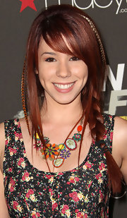 Jillian Reed styled her dark red tresses into a simple side braid.