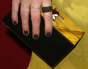 Matte slate-purple polish popped against Kate Mara's bright yellow dress at the 'Deadfall' premiere.