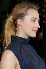 Saoirse Ronan attended the 'How I Live Now' premiere wearing her hair in an edgy ponytail.