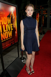 Saoirse Ronan looked youthful and stylish in a high-neck navy mini dress by Camilla and Marc during the premiere of 'How I Live Now.'