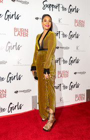 Regina Hall teamed gold lace-up heels with a velvet jumpsuit for the premiere of 'Support the Girls.'