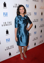 Morena Baccarin opted for a chic blue satin frock with an oversized bow detail for her red carpet look.