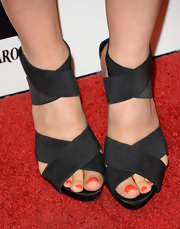 Arden Myrin chose these black strappy sandals to top off her look at the 'To the Wonder' premiere.