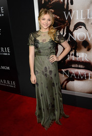 Chloe Grace Moretz kept it modest yet elegant in a moss-green sheer-overlay evening dress by Valentino during the premiere of 'Carrie.'