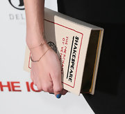 Taylor Bagley was on trend at the 'Iceman' premiere with this cute Shakespeare book clutch.