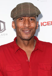 James Lesure added some flair to his casual get-up with a patterned brown ivy cap when he attended the 'Iceman' premiere.