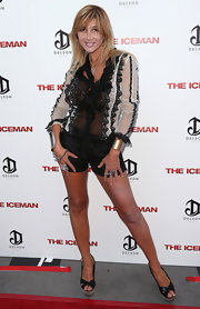 Nadeea paired black shorts with a sheer ruffle blouse for an alluring finish at the 'Iceman' premiere.