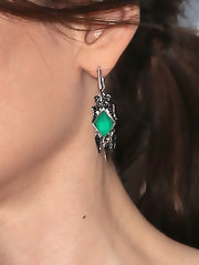 Winona Ryder accessorized with a dazzling pair of dangling gemstone earrings at the premiere of 'The Iceman.'
