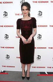 Winona Ryder looked svelte and stylish in an embroidered burgundy cocktail dress at the premiere of 'The Iceman.'