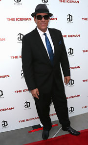 Robert Davi donned an elegant black suit and a blue silk tie for the premiere of 'The Iceman.'
