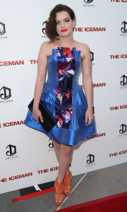 Roxane Mesquida complemented her eclectic outfit with a simple navy satin clutch when she attended the 'Iceman' premiere.