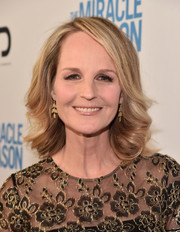 Helen Hunt attended the premiere of 'The Miracle Season' wearing her hair in feathery curls.