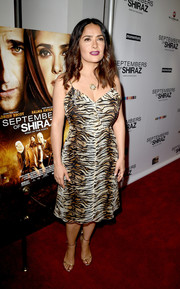 Salma Hayek sheathed her curves in a Saint Laurent tiger-print slip dress for the premiere of 'Septembers of Shiraz.'
