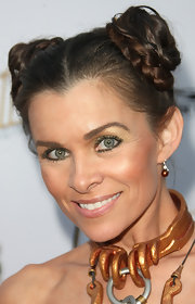 Alicia Arden attended the premiere of 'Comin-Con Episode IV' dressed as Princess Leia and with her hair in two braided buns.
