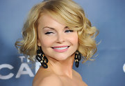 Izabella Miko accented her curled bob with circular decorative earrings.